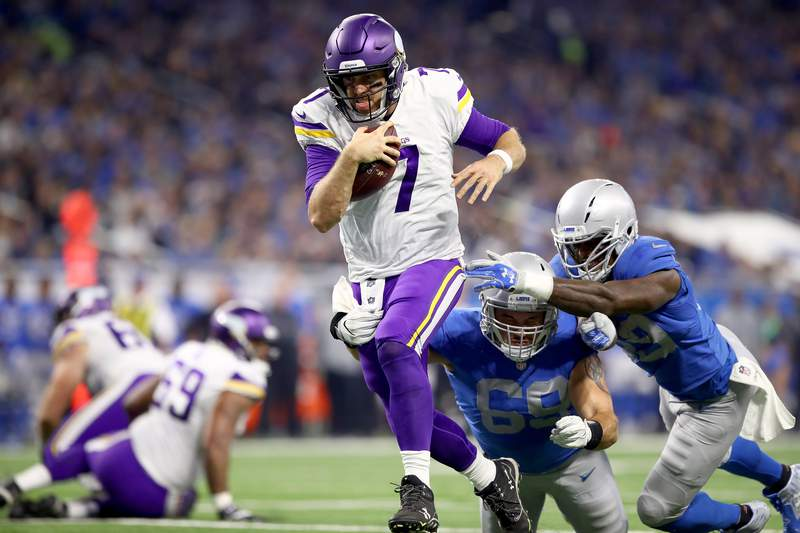 DETROIT, MI - NOVEMBER 23: Quarterback Case Keenum #7 of the Minnesota Vikings runs with the ball against Anthony Zettel #69 of the Detroit Lions and Tahir Whitehead #59 for a touchdown against the Detroit Lions during the first half at Ford Field on November 23, 2017 in Detroit, Michigan. (Photo by Gregory Shamus/Getty Images)