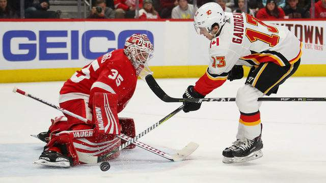Johnny Gaudreau of the Calgary Flames can't get a third period shot past Jimmy Howard of the Detroit Red Wings at Little Caesars Arena on January 02, 2019 in Detroit, Michigan. Calgary won the game 4-3. (Photo by Gregory Shamus/Getty Images)