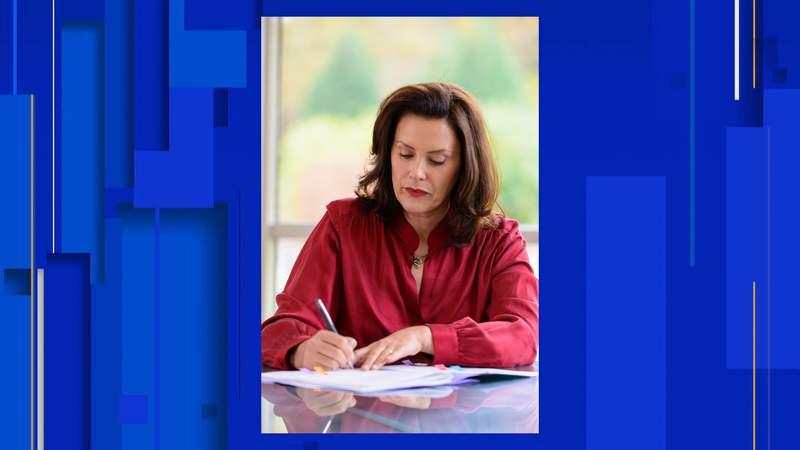 Michigan Gov. Gretchen Whitmer signing Senate Bills 886 and 991 on Oct. 20, 2020, to extend unemployment benefits.
