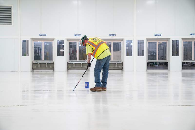 Brad Page readies the clean room Wednesday, March 25, 2020, as General Motors ramps up to begin manufacturing FDA cleared Level 1 surgical masks at its Warren, Michigan manufacturing facility.