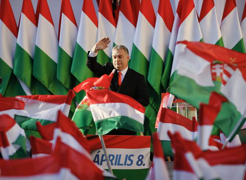 FILE - In this Friday, April 6, 2018 file photo, Prime Minister Viktor Orban waves during the final electoral rally of his Fidesz party in Szekesfehervar, Hungary. After a landslide 2018 election victory, Orban talks about Hungarys system of national cooperation, a process that has hobbled the court system, re-written the constitution and given immense power to himself and his party. (AP Photo/Darko Vojinovic, File)