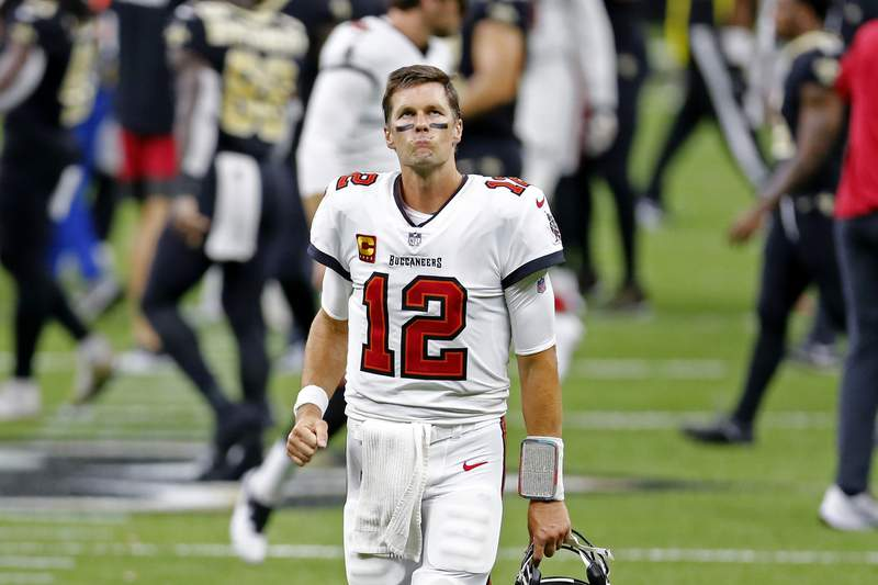 Tampa Bay Buccaneers quarterback Tom Brady (12) reacts after an NFL football game against the New Orleans Saints in New Orleans, Sunday, Sept. 13, 2020. The Saints won 34-23. (AP Photo/Brett Duke)