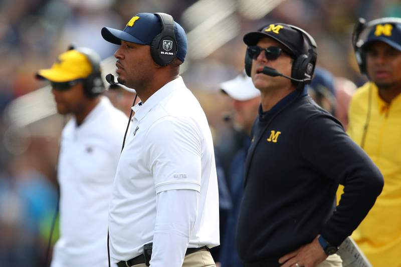 Offensive coordinator Josh Gattis looks on with head coach Jim Harbaugh while playing the Iowa Hawkeyes at Michigan Stadium on October 05, 2019 in Ann Arbor, Michigan. Michigan won the game 10-3.