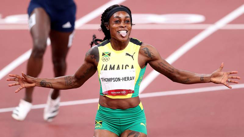 TOKYO, JAPAN - AUGUST 03:  Elaine Thompson-Herah of Team Jamaica celebrates after winning the gold medal in the Women's 200m Final on day eleven of the Tokyo 2020 Olympic Games at Olympic Stadium on August 03, 2021 in Tokyo, Japan. (Photo by Christian Petersen/Getty Images)