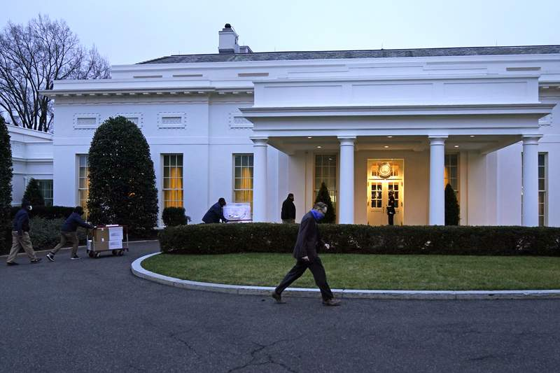 Workers cart boxes into the West Wing of the White House, as offices in the White House complex are being packed up and moved out, Friday, Jan. 15, 2021, in Washington. (AP Photo/Gerald Herbert)
