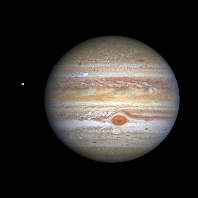 This Aug 25, 2020 image captured by NASA's Hubble Space Telescope shows the planet Jupiter and one of its moons, Europa, at left, when the planet was 406 million miles from Earth. The new photo was released by the Space Telescope Science Institute in Baltimore on Thursday, Sept. 17, 2020. (NASA, ESA, STScI, A. Simon, M. via AP)