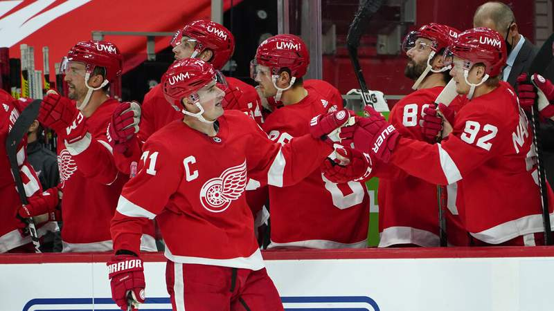Detroit Red Wings center Dylan Larkin (71) celebrates his goal against the Carolina Hurricanes in the third period of an NHL hockey game Saturday, Jan. 16, 2021, in Detroit. (AP Photo/Paul Sancya)