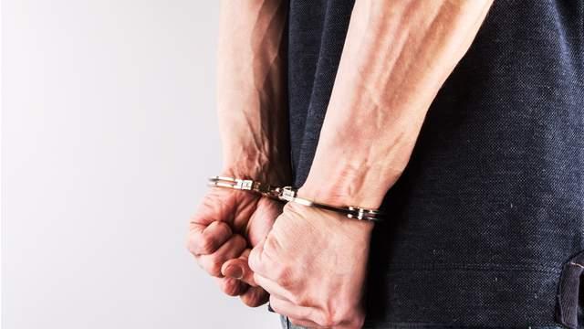 A man wearing handcuffs.