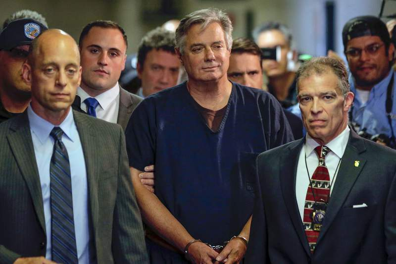 FILE - In this June 27, 2019 file photo, Paul Manafort, center, arrives at court in New York. In paperwork made public on Thursday, July 2, 2020. New York appellate judges on Thursday, Oct. 22, 2020, have upheld a lower judges decision to dismiss state mortgage fraud charges against Paul Manafort on double jeopardy grounds. (AP Photo/Seth Wenig, File)