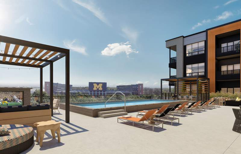 Hoover + Greene's elevated pool deck with views of Michigan Stadium.