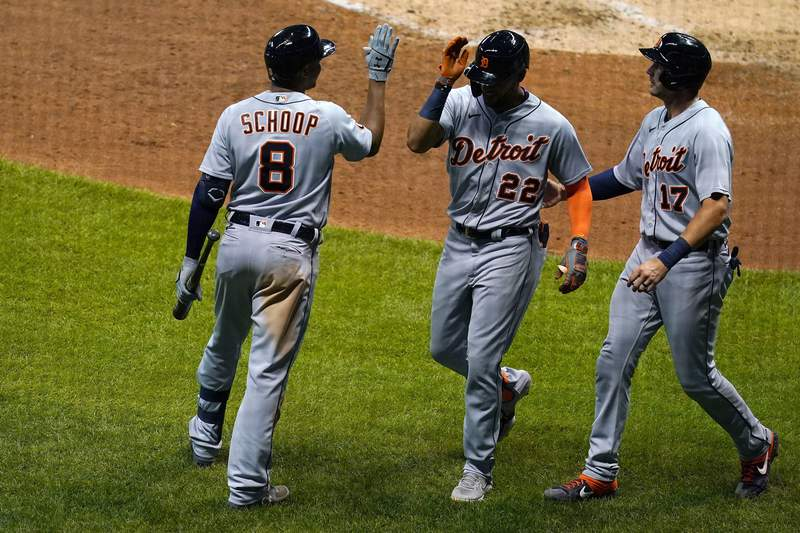 Victor Reyes #22 of the Detroit Tigers is congratulated by Jonathan Schoop #8 and Grayson Greiner #17 following a home run against the Milwaukee Brewers during the sixth inning at Miller Park on September 01, 2020 in Milwaukee, Wisconsin.