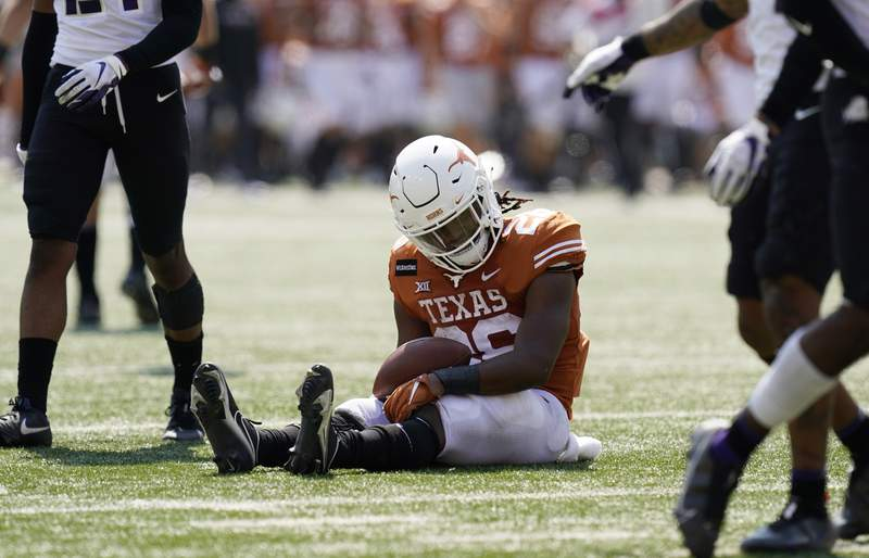 Texas running back Keaontay Ingram (26) reacts after he was stopped short of a touchdown on a run against TCU during the second half of an NCAA college football game, Saturday, Oct. 3, 2020, in Austin, Texas. (AP Photo/Eric Gay)