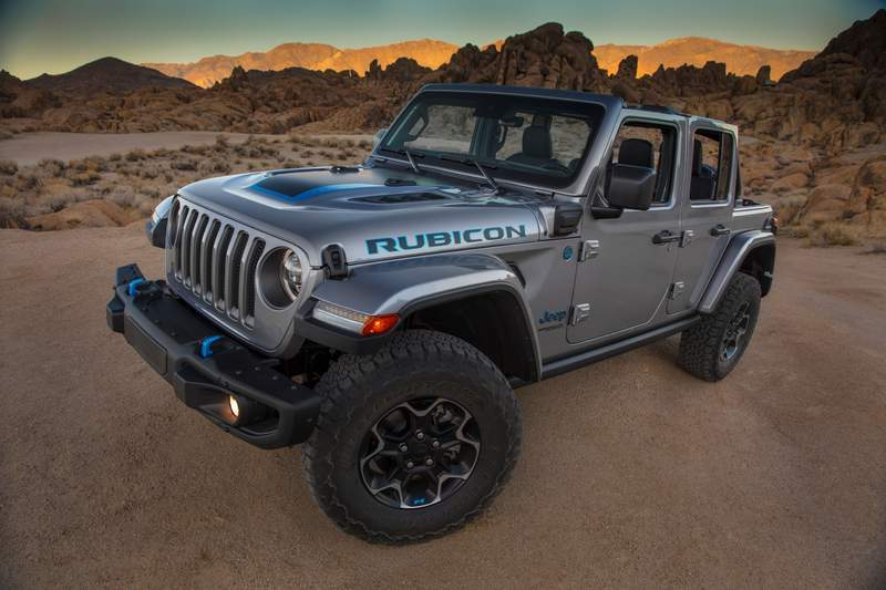 This photo provided by Fiat Chrysler shows the 2021 Jeep Wrangler Rubicon 4xe.  Fiat Chrysler on Thursday, Sept. 3, 2020, unveiled the first of what it says will be many Jeeps powered by batteries. The Jeep Wrangler 4xe is the brand's first vehicle that can travel on electricity in the U.S. The gas-electric hybrid SUV can go 25 miles on battery power before a 2-liter, four-cylinder turbocharged engine takes over. (Fiat Chrysler via AP)