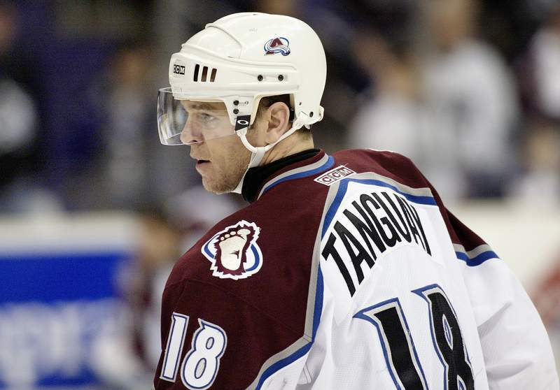 LOS ANGELES - JANUARY 29:  Alex Tanguay #18 of the Colorado Avalanche looks on during a break in game action against the Los Angeles Kings on January 29, 2004 at Staples Center in Los Angeles, California.  The Avalanche and the Kings skated to a 3-3 tie. (Photo by Victor Decolongon/Getty Images)