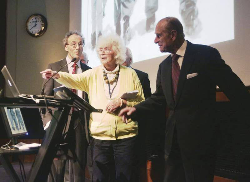 FILE - In this May 29, 2013 file photo, travel writer, journalist and author, Jan Morris, center, with the Duke of Edinburgh, right, during a reception to celebrate the 60th Anniversary of the ascent of Everest, at the Royal Geographical Society in London. Morris, the celebrated journalist, historian, world traveler and fiction writer who became a pioneer of the transgender movement, has died at 94. Her literary representative, United Agents, says Morris died in Wales on Friday, Nov. 20, 2020. (Yui Mok/PA via AP, file)