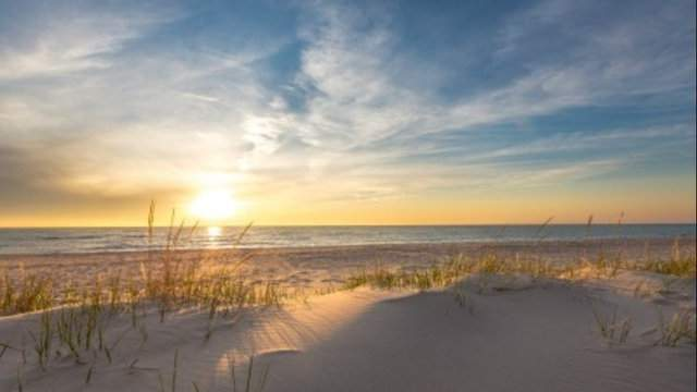The view of a sunset at Michigan's Sleeping Bear Dunes National Lakeshore is one of the most famous in the state. (WDIV)