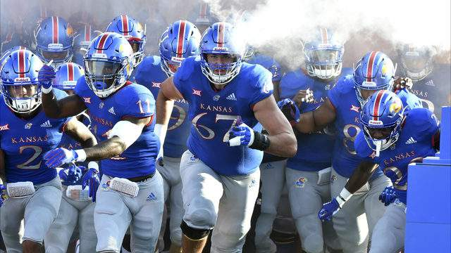 Members of the Kansas Jayhawks run onto the field prior to a game against the Nicholls State Colonels in the first quarter at Memorial Stadium on September 1, 2018 in Lawrence, Kansas. (Photo by Ed Zurga/Getty Images)