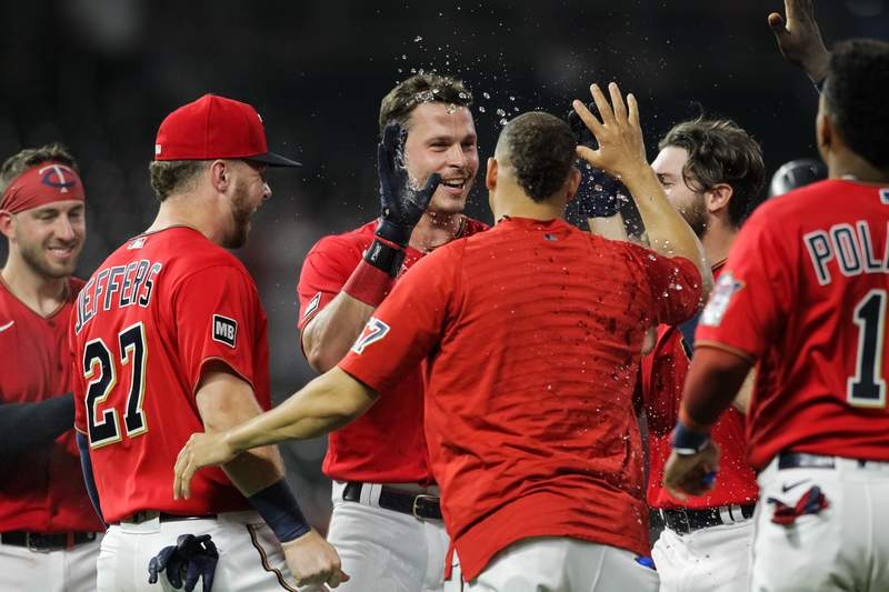 MINNEAPOLIS, MN - JULY 26: Max Kepler #26 of the Minnesota Twins celebrates his walk-off RBI single with teammates against the Detroit Tigers at Target Field on July 26, 2021 in Minneapolis, Minnesota. The Twins defeated the Tigers 6-5 in ten innings. (Photo by David Berding/Getty Images)