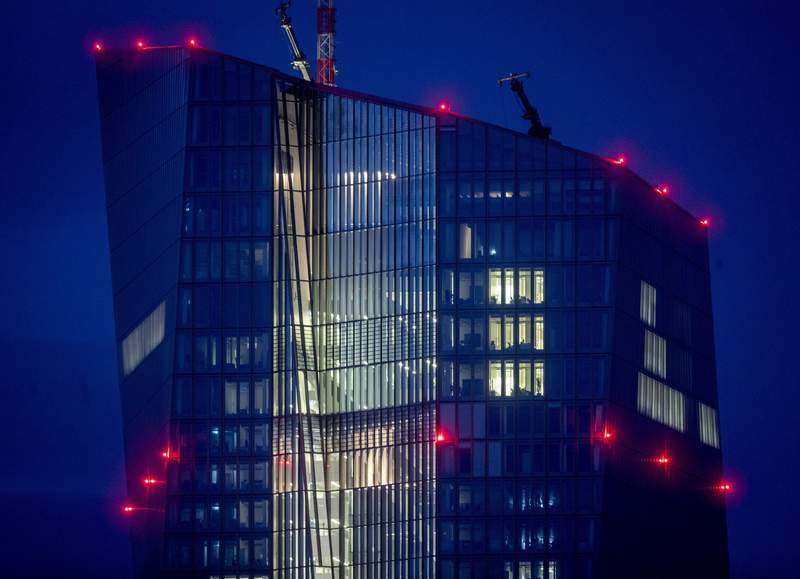 FILE - In this Oct.5,2020 file photo red warning lights shine on the building of the European Central Bank in Frankfurt, Germany. The European Central Bank is expected to leave its stimulus efforts running full steam Thursday _ even as the economy in the 19 countries that use the euro currency shows more and more signs of a robust recovery as pandemic restrictions ease. (AP Photo/Michael Probst,file)