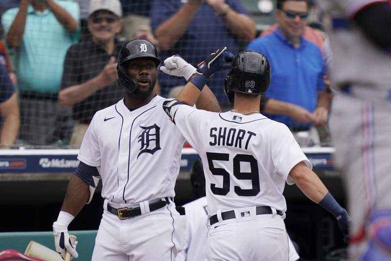 Detroit Tigers' Zack Short is greeted by Akil Baddoo after a solo home run during the fourth inning of a baseball game against the Texas Rangers, Thursday, July 22, 2021, in Detroit.