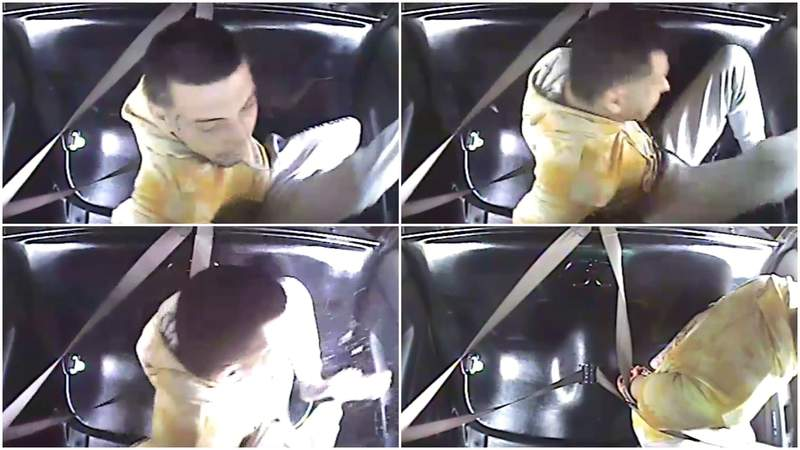 Rocky Hernandez kicking out the window of a Troy police car.
