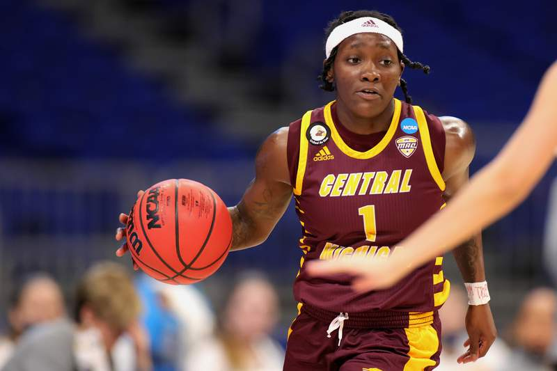 Micaela Kelly #1 of the Central Michigan Chippewas controls the ball during the second half in the first round game of the 2021 NCAA Women's Basketball Tournament at the Alamodome on March 21, 2021 in San Antonio, Texas.