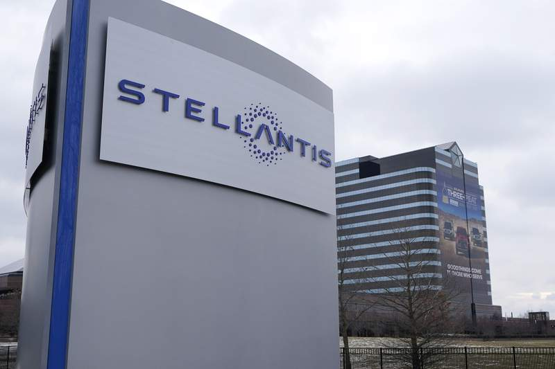 FILE - This Jan. 19, 2021 file photo shows the Stellantis sign outside the Chrysler Technology Center in Auburn Hills, Mich. Automaker Stellantis NV, which was formed earlier this year by a merger involving Fiat Chrysler, said Wednesday, Sept. 1 it will pay $285 million for an auto-finance company to provide loans and leases to customers through its dealers. Netherlands-based Stellantis said it will pay cash to acquire F1 Holdings Corp., the parent of Houston-based auto-finance firm First Investors Financial Services Group. The deal is expected to close by year end. (AP Photo/Carlos Osorio)