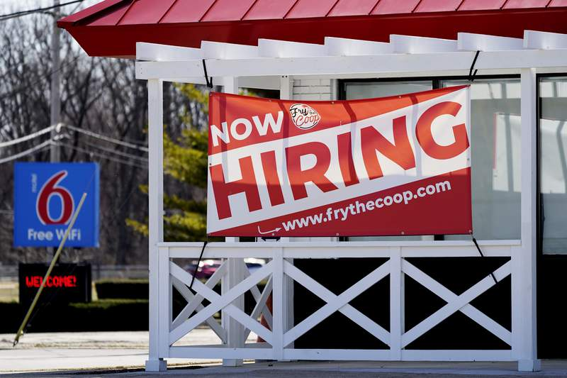 A hiring sign shows outside of restaurant in Prospect Heights, Ill., Sunday, March 21, 2021.  The number of people seeking unemployment benefits fell sharply last week to 684,000, the fewest since the pandemic erupted a year ago and a sign the economy is improving.  (AP Photo/Nam Y. Huh)