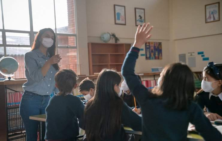 A teacher instructs a lesson during the pandemic.