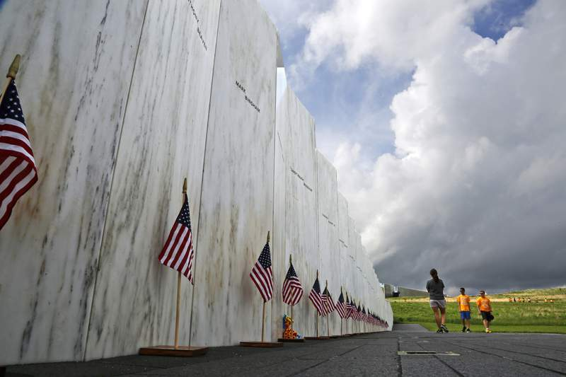 FILE  In this May 31, 2018, file photo, visitors to the Flight 93 National Memorial pause at the Wall of Names honoring 40 passengers and crew members of United Flight 93 killed when the hijacked jet crashed at the site during the 9/11 terrorist attacks, near Shanksville, Pa. (AP Photo/Gene J. Puskar, File)