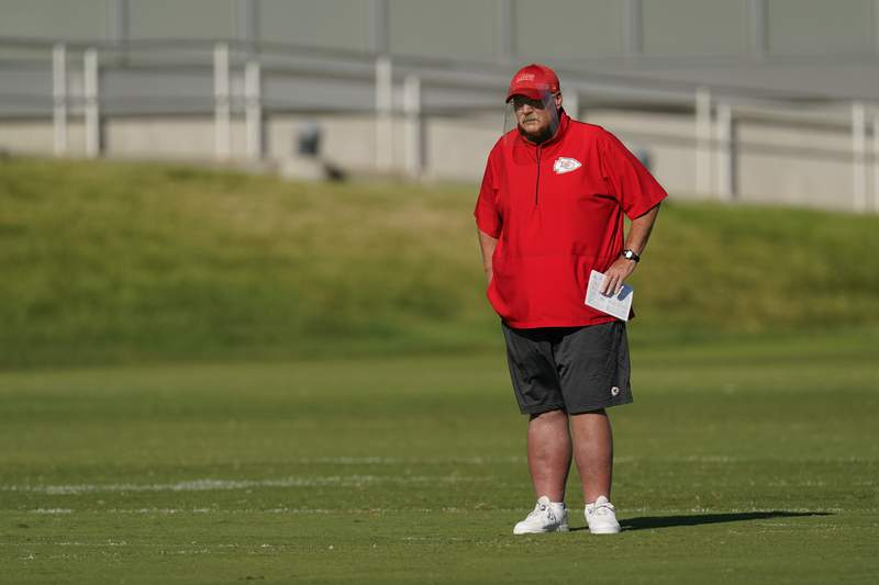 Kansas City Chiefs head coach Andy Reid watches workouts during an NFL football training camp practice Thursday, Aug. 27, 2020, in Kansas City, Mo. (AP Photo/Charlie Riedel)