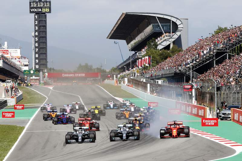 FILE - In this May 12, 2019 file photo, Mercedes driver Lewis Hamilton, left, of Britain leads the field after the start of the Spanish Formula One race at the Barcelona Catalunya racetrack in Montmelo, just outside Barcelona, Spain. Joan Fontsere, the general manager of the Circuit de Barcelona-Catalunya, says Formula One organizers are open to renegotiating hosting fees for races that may take place without fans this season because of the coronavirus pandemic. (AP Photo/Joan Monfort, File)