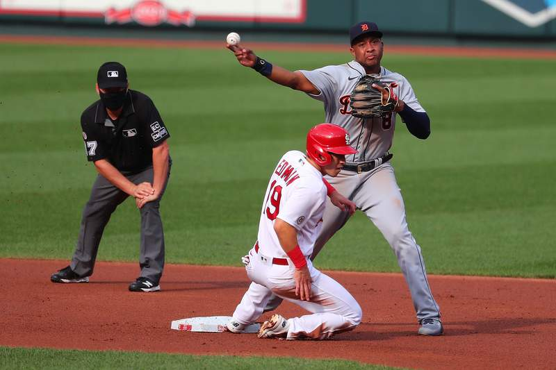 Jonathan Schoop #8 of the Detroit Tigers turns a double play over Tommy Edman #19 in the first inning during game two of a doubleheader at Busch Stadium on September 10, 2020 in St Louis, Missouri.