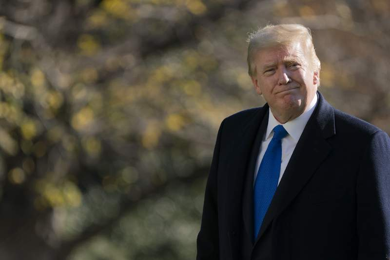 President Donald Trump walks on the South Lawn of the White House in Washington, Sunday, Nov. 29, 2020, after stepping off Marine One. Trump is returning from Camp David. (AP Photo/Patrick Semansky)
