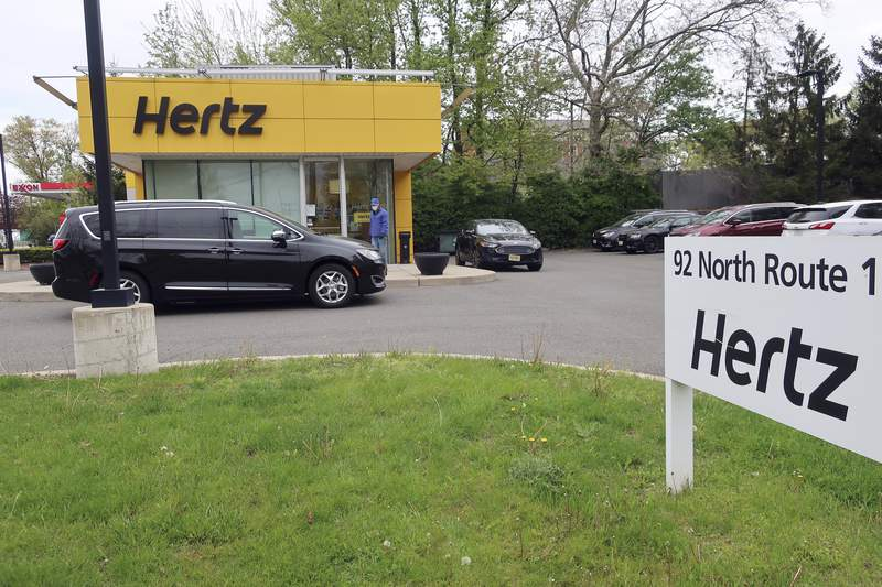 FILE - In this May 6, 2020, file photo, a Hertz car rental is closed during the coronavirus pandemic in Paramus, N.J.  A bankruptcy court has confirmed Hertzs reorganization plan, Thursday, June 10, 2021, which helps clear the way for the car rental company to emerge from Chapter 11 bankruptcy protection by the end of the month.  (AP Photo/Ted Shaffrey, File)
