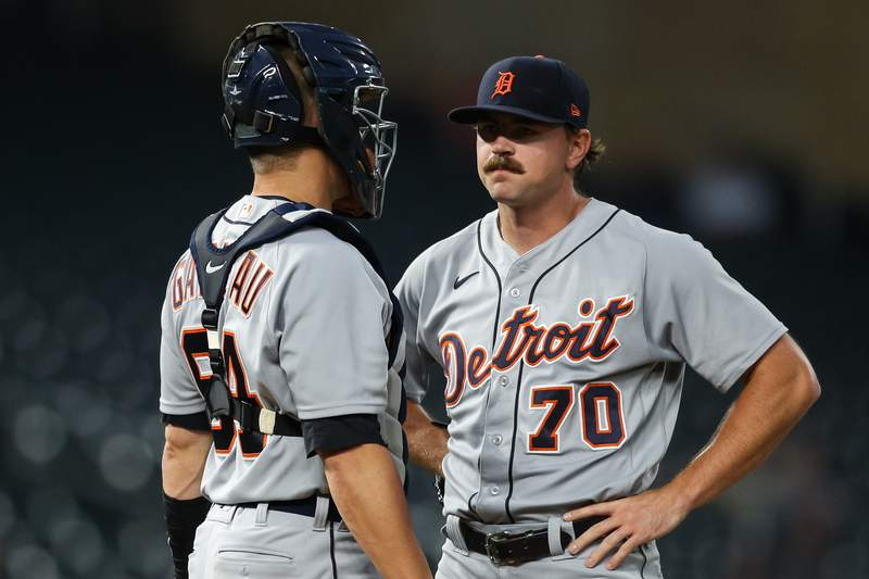 Dustin Garneau #64 talks to Tyler Alexander #70 of the Detroit Tigers in the first inning of the game against the Minnesota Twins at Target Field on September 28, 2021 in Minneapolis, Minnesota.