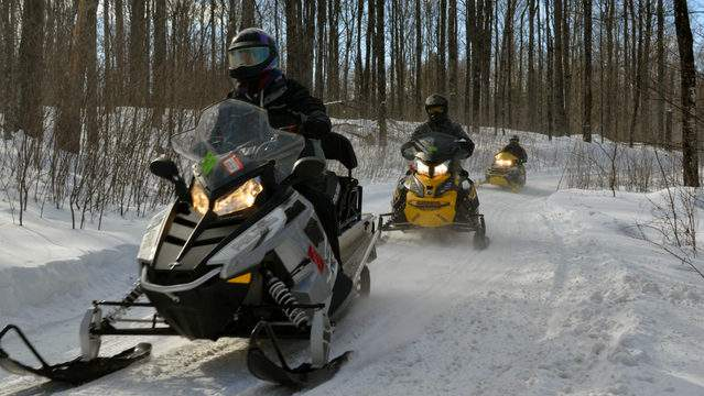 A group of snowmobilers riding right in Gogebic County on a cold day during the winter of 2017-2018. (Photo: Michigan DNR)