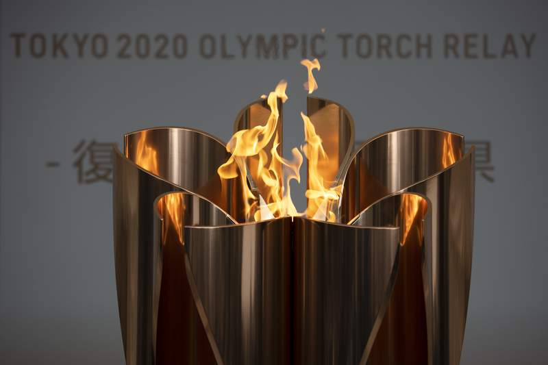 FILE - In this March 24, 2020, file photo, the Olympic Flame burns during a ceremony in Fukushima City, Japan. The Olympic flame is going to be on display until the end of April in Japan's northeastern prefecture of Fukushima. Tokyo Olympic and prefecture officials held an official handover ceremonyon Wednesday, April 1, at the J-Village National Training Center in Fukushima.(AP Photo/Jae C. Hong, File)