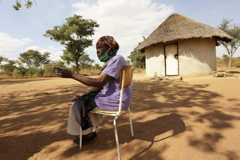 Matrida Tendayi, from Dema communal lands east of the capital Harare, Zimbabwe, talks at her homestead Wednesday, June, 23, 2021. (AP Photo/Tsvangirayi Mukwazhi)