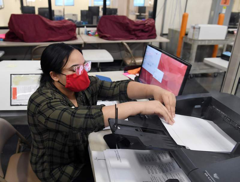 A Clark County election worker scans mail-in ballots at the Clark County Election Department on November 4, 2020 in North Las Vegas, Nevada. U.S.(Photo by Ethan Miller/Getty Images)