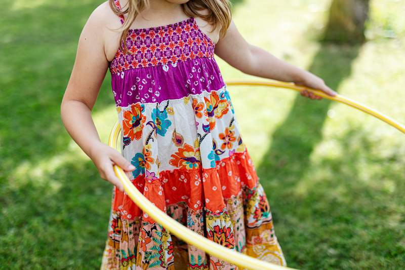 A girl with a hula hoop.
