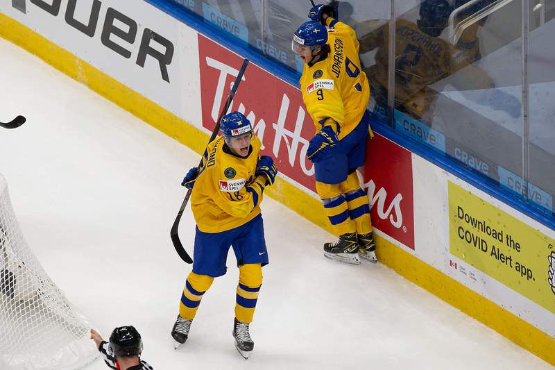 EDMONTON, AB - JANUARY 02: Lucas Raymond #18 and Albert Johansson #9 of Sweden celebrate a goal against Finland during the 2021 IIHF World Junior Championship quarterfinals at Rogers Place on January 2, 2021 in Edmonton, Canada. (Photo by Codie McLachlan/Getty Images)