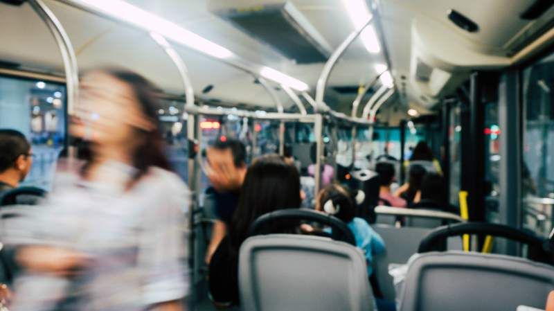 Passengers on a bus ride.
