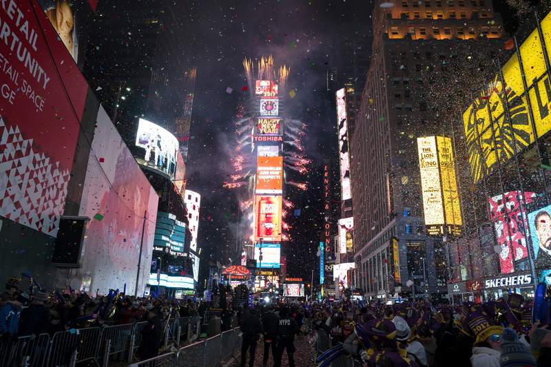 """FILE - In this Jan. 1. 2017 file photo, confetti falls as people celebrate the new year in New York's Times Square. This year's New Year's Eve celebration in Times Square will spotlight efforts to combat climate change when high school science teachers and students press the button that begins the famous 60-second ball drop and countdown to next year. On New Years Eve, we look back and reflect on the dominant themes of the past year, and seek hope and inspiration as we look forward,"""" Times Square Alliance President Tim Tompkins said in a statement Saturday, Dec. 28, 2019 announcing the plan. He said the honorees are working to solve this global problem through science. (AP Photo/Craig Ruttle, File)"""
