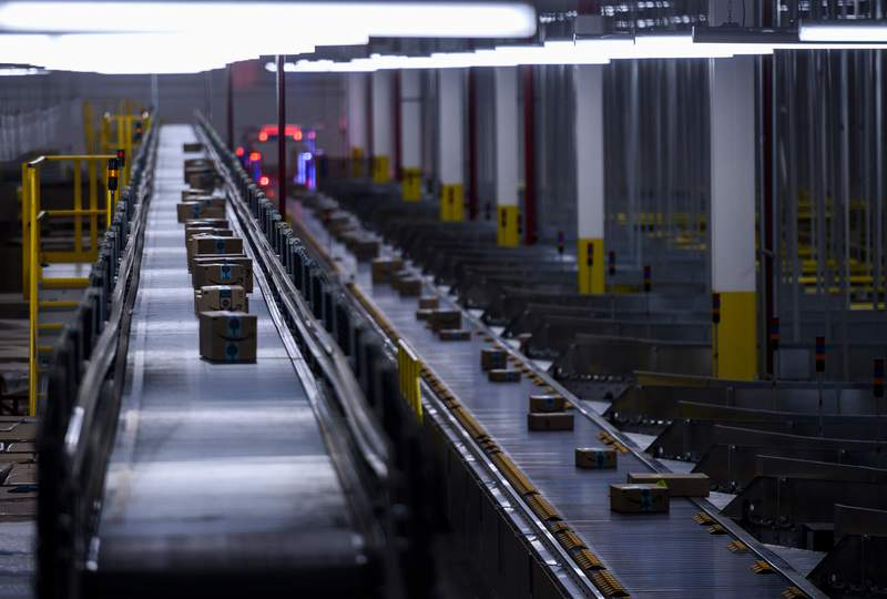 Orders move down a conveyor belt at the 855,000-square-foot Amazon fulfillment center in Staten Island, one of the five boroughs of New York City, on February 5, 2019. - Inside a huge warehouse on Staten Island thousands of robots are busy distributing thousands of items sold by the giant of online sales, Amazon. (Photo by Johannes EISELE / AFP)        (Photo credit should read JOHANNES EISELE/AFP via Getty Images)
