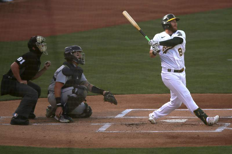 Robbie Grossman #8 of the Oakland Athletics hits a home run against the Seattle Mariners in the first inning of their second game of a double header at RingCentral Coliseum on September 26, 2020 in Oakland, California.