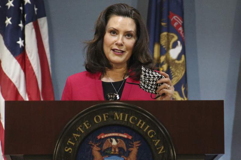 FILE - In this Thursday, May 21, 2020 file photo provided by the Michigan Office of the Governor, Michigan Gov. Gretchen Whitmer speeks during a news conference in Lansing, Mich. (Michigan Office of the Governor via AP, Pool) File