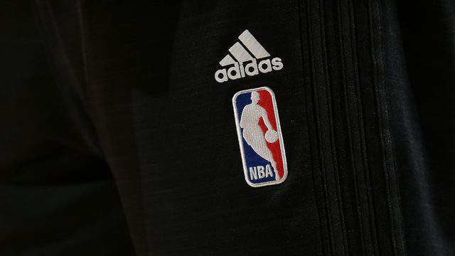 DENVER, CO - NOVEMBER 09: A detail photo of the NBA logo on the Adidas warm up if the Portland Trail Blazers as the prepare to face the Denver Nuggets at Pepsi Center on November 9, 2015 in Denver, Colorado. (Photo by Doug Pensinger/Getty Images)