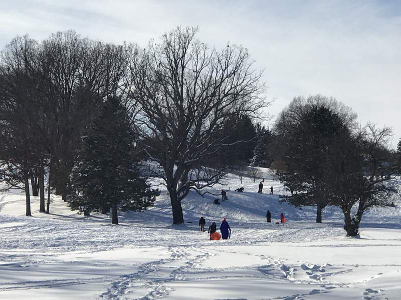 People are seen sledding at Huron Hills Golf Course on Dec. 14, 2017 in Ann Arbor.