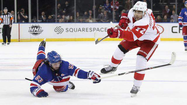 Andreas Athanasiou of the Detroit Red Wings scores an empty net goal at 19:06 of of the third period against the New York Rangers at Madison Square Garden on March 19, 2019 in New York City. (Photo by Bruce Bennett/Getty Images)